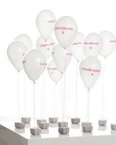 Help your reception take flight with floating escort cards that double as centerpieces once guests find their tables