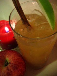 Caramel Apple Highball with Van Gogh Dutch Caramel Vodka, apple juice, lemon juice, cinnamon schnapps, and a cinnamon stick for garnish.