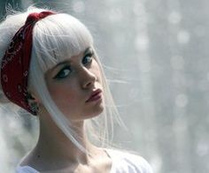 chunky bangs, white blonde, strong eye brow and makeup, fair skin