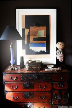 An assortment of objects atop a chest in his living room.
