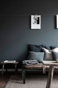 Charcoal is a soothing paint color for the living room, accent with textures of linen and sheepskin and adorn with black and white photography...