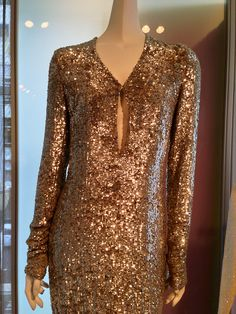 What are you doing New Years Eve?  Hopefully wearing something as glamorous as this Molly Newhouse sequin gown.