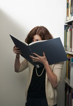 """""""Smelling the Books"""" - Rachel Morrison, MoMA. This artist has made an ongoing performance of smelling every book in the MoMA Library collection."""