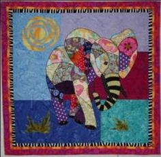 Ellie, An Animal Quilt Pattern by Barbara J. Jones of bj designs and patterns.  Ellie makes a great baby quilt, wouldn't this be fun on the nursery room wall.