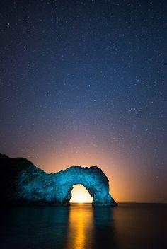 Backlit Durdle Door, Dorset on the Jurassic Coast, England