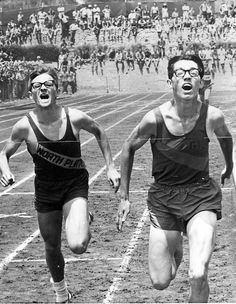 Only the thinnest of margins separated North Platte's Dan Speck, left, and Grand Island's Lynn Hall in the Class A mile race at the Nebraska state track meet in Kearney on May 23, 1970. Hall won in a record 4:16. THE WORLD-HERALD