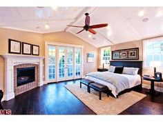 Dream Master Bedroom; vaulted ceilings, french doors, brick fireplace, dark hardwood floors, recessed lighting, LOTS of natural light.