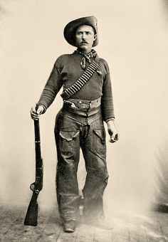 This Ranger, is dressed in functional cowboy gear that is typical of clothing worn by the Rocky Mountain Rangers. His hat identifies the one concession to military dress code: the upturned brim signifies affiliation with the Canadian Militia. The 1876 Winchester .45-75 was the Rangers weapons of choice  This Ranger also has a Smith & Wesson New Model No. 3 single-action revolver tucked in in his chaps.