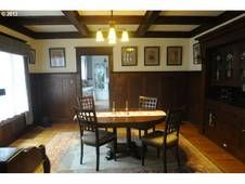 Nice unpainted interior millwork and box beam ceilings. Too bad about those pictures. Built 1910. $500K.