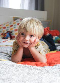 Project Nursery - Beau of Theo and Beau on his new Naturepedic kids twin mattress! #theoandbeau
