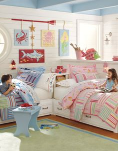 I love how white walls and furniture anchor the decor accessories in this boy and girl shared bedroom. The pink and blue bedding from Pottery Barn Kids works well together. The personalized pillows are a nice touch. For more kids room decorating and organizing ideas visit https://www.facebook.com/KidsRoomDecor you may find something you 'LIKE'