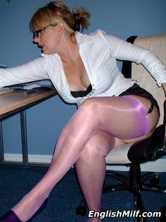 Sexy busty British secretary in short mini skirt, pink nylon stockings and heels. Daniella English the English MILF nylons women in stockings UK blonde.