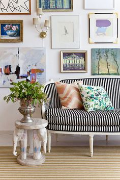 Gallery wall and striped sofa.