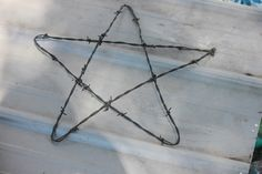 barbed wire star - oh the ideas this gives me!!!