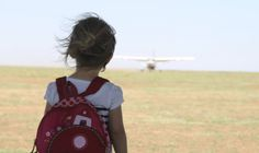 Young girl waiting her plane to Naboisho Camp in Kenya. Family safari holidays.
