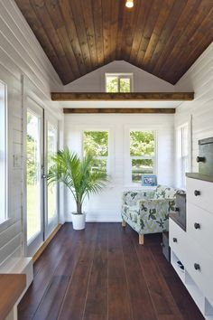 -floors 133 sq. ft. Amalfi Tiny House has beautiful wood floors and ceiling and white walls and cabinets. | Tiny Homes