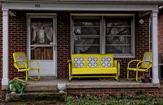 I am really digging this front porch furniture.. the windows and door need a little updating, but the yellow furniture rocks!!!
