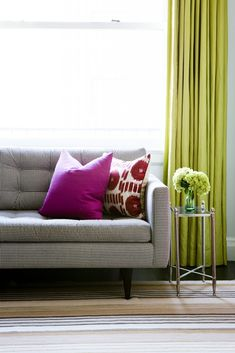 Tour a Cheerful and Elegant Family Home in NYC // checkered upholstery, magenta pillow, ikat pillow, mirrored side table, lime green curtain, striped rug