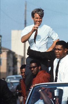 The Kennedy campaign travels through the Watts section of Los Angeles on the last day before the primary, 1968