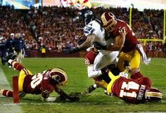 After quarterback Russell Wilson helped clear the way, Seattle running back Marshawn Lynch (24) finished the job, taking four Washington players with him into the end zone. The Seahawks beat Washington, 24-14. (Photo by John Lok / The Seattle Times)