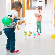 Create a numbered bottle bowling game to play with your toddler. Each round will encourage counting and basic addition skills!