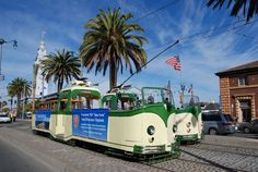 """San Francisco's two """"boat trams,"""" originally from Blackpool, England, pose together for the first time on The Embarcadero during Muni Heritage Weekend. The new acquisition by Market Street Railway, No. 233, made possible by a generous grant from the Thoresen Foundation and a shipping subsidy from FedEx Trade Networks, is to the left, with No. 228 to the right. - See more at: http://www.streetcar.org/blog/2013/11/muni-heritage-weekend-same-time-next-year.html#sthash.DkhJmVW1.dpuf"""