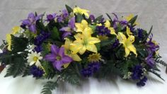 Headstone spray with purple and yellow Tiger Lilies.