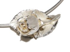 A rose & leaf pendant I created again using cutters & techniques I learnt from cold porcelain flower making. Each petal was attached separately & dried before adding the next.