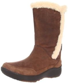 Clarks Women's Clarks Wave.Shelter Boot.  $194.95 - $195.00            Take cold weather by storm with this attractive mid-calf boot from Clarks. The Wave.Shelter features a burnished leather upper with a cozy faux shearling detail on the topline and shaft. Beneath, a grippy rubber sole delivers traction for a steady stride on or off the street.