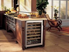Unlike a wine fridge, a beverage center is a more family-friendly appliance, chilling cans and bottles of juice, soda, water and beer.