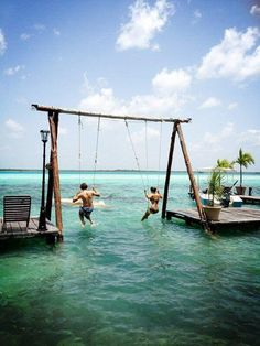 I want this swing set!  You could go as high as you could and then fly off into the water safely!  That would be so fun :)