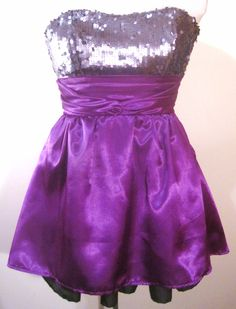 Dream Girl - Strapless with charcoal stretch sequins bodice. Midriff has gathered in the center piece in deep purple satin.  Deep purple skirting is slightly flared with black nylon petticoat showing.