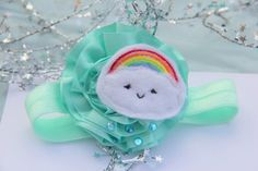 Sweet  little raincloud satin shimmer aqua cloud and rainbow headband with sparkly drops- a super cute and fun hair accessory for girls. $10.00, via Etsy.