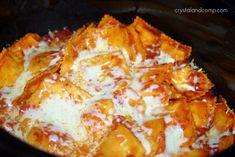 CROCKPOT RAVIOLI  25oz bag ravioli, 1jar spaghetti sauce, 1c mozzarella, dump ravioli into crockpot, pour sauce in, stir evenly & carefully, cover and cook on high for 2.5-3hrs, add cheese and let melt.