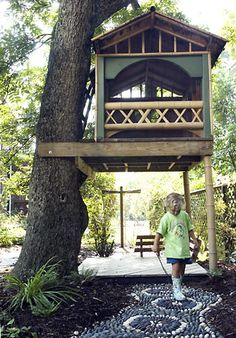 50 Kids Treehouse Designs...low tree house with tent frame and small front ladder.