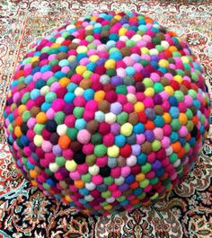 How cool is this felt ball ottoman!