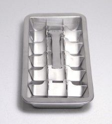 Metal ice cube tray. Pull the handle up and out pops the ice!