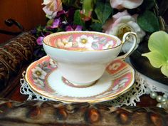 Antique  EB Foley China Tea Cup Teacup and Saucer - Christmas Rose - England 7949. $33.00, via Etsy.