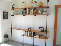 Got the idea from the Ace Hotel and made this bookcase from pipes and plywood