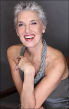 Beautiful gray hair tones with the dress and her skin