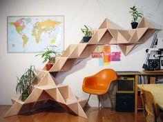 J1studio's T.SHELF or triangular shelf is a modular system that allows you to sculpt armies of triangles into any form you like. You can vary widths, lengths and depths, plus go on to snake these sculpture-like forms across walls or floors.