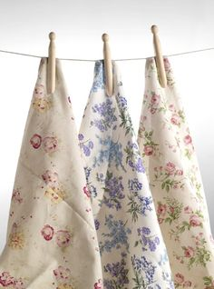 lovely floral dish towels on clothesline