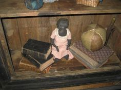Early Black Doll with stitched features and yarn hair......Unusually shaped hands and feet.....
