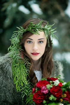 winter bride hair and make up with cascading greenery halo #bride #weddinglook #weddingchicks http://www.weddingchicks.com/2014/03/27/winter-romance-wedding-ideas/