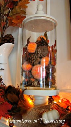 Fill apothecary jars with seasonal decor, like fall leaves, pine cones, and baby pumpkins.