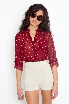 High wasted shorts and red blouse