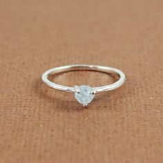 another perfect promise ring :) his birthstone <3