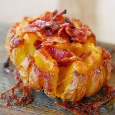 Take Two: Bloomin' Baked Potatoes! My family enjoyed the bloomin baked apples so much that we made these cheese and bacon smothered potatoes! Recipe is on my blog today.