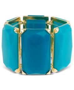 This will bling out your wrist and you won't need nothing else.  Haskell Bracelet, Gold Tone Teal Bead Stretch Bracelet - Fashion Jewelry - Jewelry & Watches - Macy's
