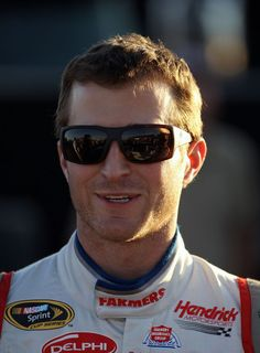 Kasey Kahne Kasey Kahne, driver of the #5 Farmers Insurance Chevrolet, stands by his car after qualifying for pole position in the NASCAR Sp...